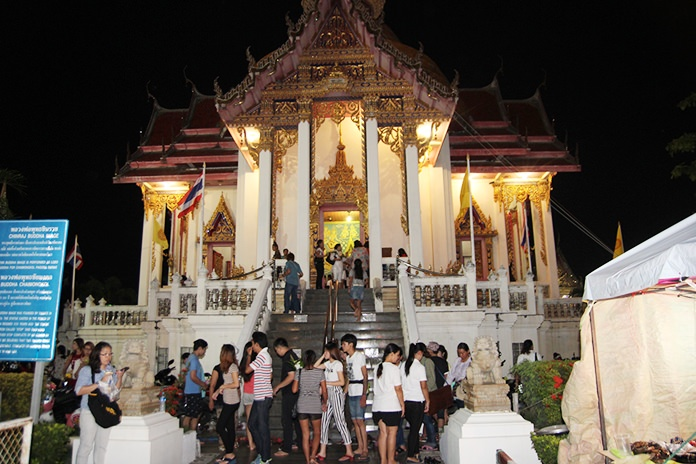 Thailand's temples always look ornate, but are especially beautiful during Buddhist holidays.