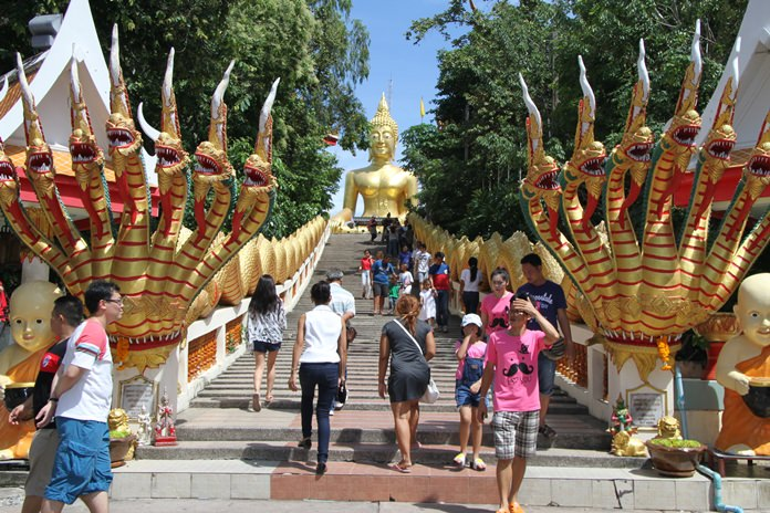 On two of the four holiest days of the year, area Buddhists followed custom by gathering at temples across Pattaya. Shown here, tourists flock to picturesque Big Buddha Hill in South Pattaya for Asalaha Bucha Day and Khao Phansa last week.