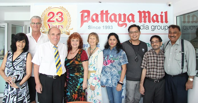 (L to R) Sue Kakarja, Jo Klemm, Dr Otmar Deter, Elfi Seitz, Dr. Margret Deter, Malee Malhotra, Victor Wong, Marlowe Malhotra and Peter Malhotra pose for a commemorative 23rd Anniversary photo.