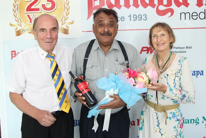 Dr. Otmar and Margret Deter, President and secretary of the Rotary Club of Dolphin Pattaya International present Peter with a rare bottle of Austrian wine.