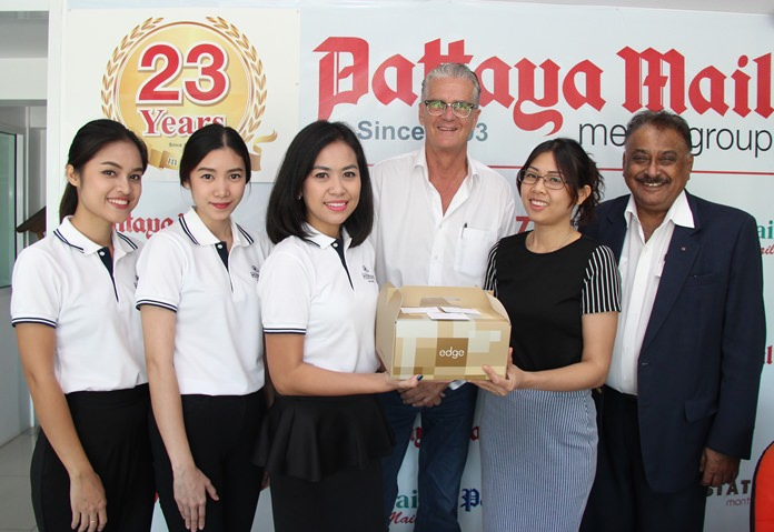 Parapa Teerasoontornkul 'Por' MarCom Manager and her team from the Hilton Pattaya present a gift to Nutsara Duangsri, Deputy Sales and Marketing Manager of Pattaya Mail.