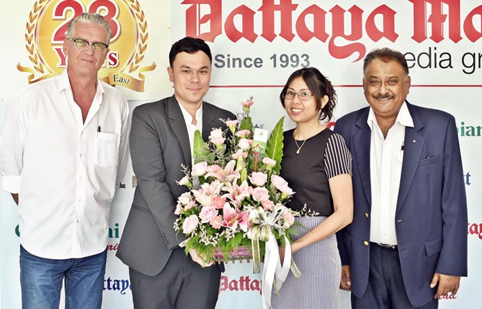 Thanagon Poungbubpchart 'Pete' PR & MarCom Manager of Holiday Inn presents a beautiful bouquet to Nutsara of Pattaya Mail. At left is Jo Klemm, International Marketing of GO Property Thailand.