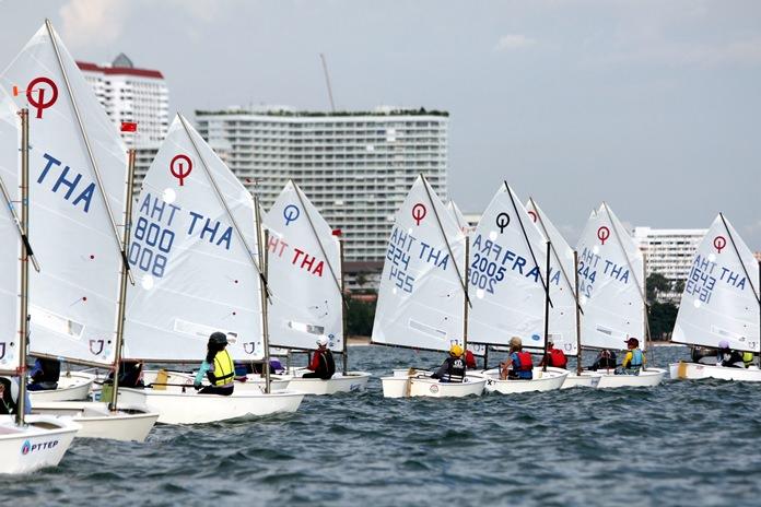 Optimist sailors battle for position.