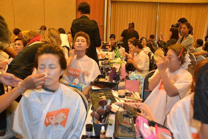 Contestants work hard at preparing their models to look their best.
