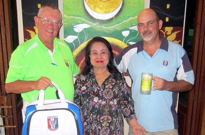 Dave Nicholson (right) and Dick Warberg (left) pose with Lek from BJ's Holiday Lodge.