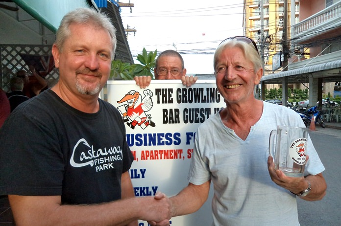 Monthly Mug winner Patrick Poussier (right) with Stuart Brown.