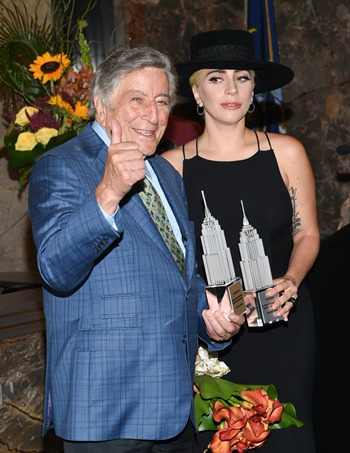 Singers Tony Bennett (left) and Lady Gaga appear at a ceremony to light the Empire State Building in honor of Bennett's 90th birthday on Wednesday, Aug. 3, 2016, in New York. (Photo by Evan Agostini/Invision/AP)
