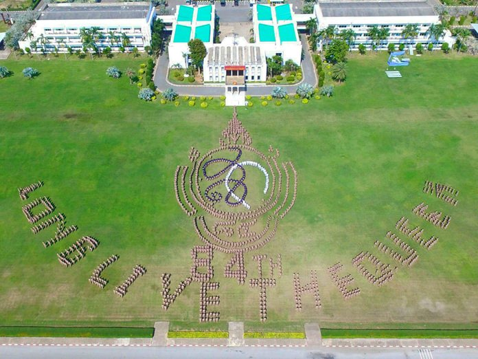 """About 2,000 Royal Thai Navy sailors lined up in a formation that spelled out """"Long live the Queen"""" to mark her 84th birthday."""