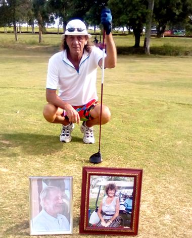 Potsy on the tee with photos of Barry and Trudy Chadbourn.