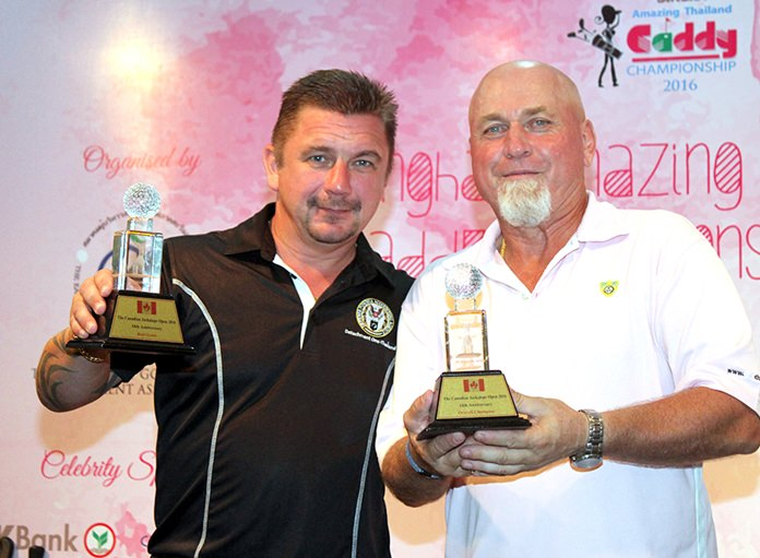 Jason Manley (left) receives his trophies from Murray Kerr (right) after winning the 18th Annual Jackalope Open.
