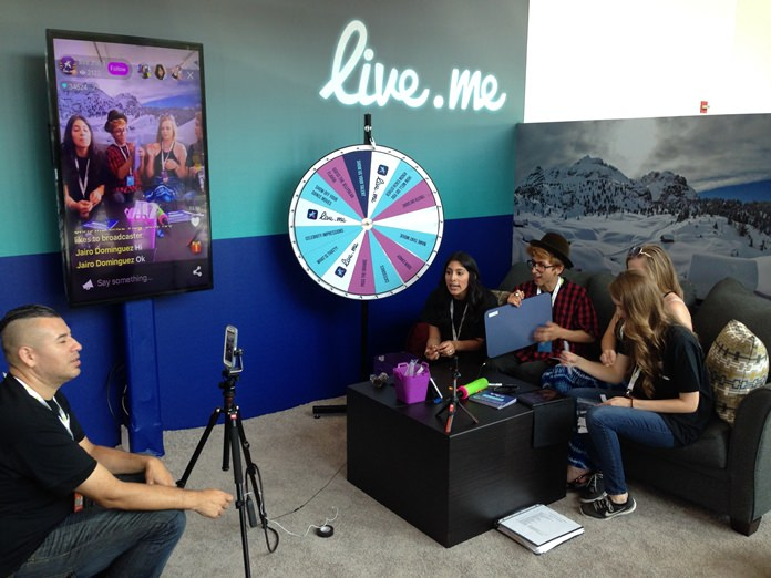 In this Thursday, June 23, 2016, photo, Erick Armas, left, captures video of, from right, Jordan Hoyle, Violet Summersby, George Padilla and Sue Evelyn Gil, who were live broadcasting from the live.me booth at VidCon, an annual convention for the fans of stars from YouTube, Vine, Instagram and other video platforms, at the Anaheim Convention Center in Anaheim Cailf. Facebook, Twitter and Amazon-owned Twitch are pouring resources and money into live video streaming. Although it can feel like a throwback to appointment TV, interactions with fans can create a new stream of revenue from tips. (AP Photo/Ryan Nakashima)