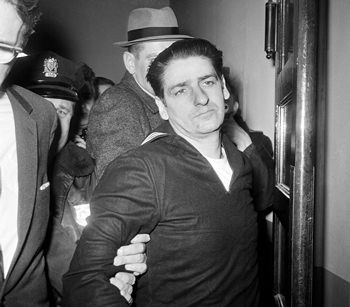 In this Feb. 25, 1967 black and white file photo, self-confessed Boston Strangler Albert DeSalvo is taken into custody after his capture north of Boston in Lynn, Mass. (AP Photo/Frank C. Curtin)