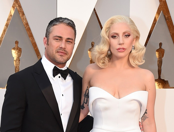Taylor Kinney (left) and Lady Gaga are shown together in this Feb. 28, 2016, file photo. (Photo by Jordan Strauss/Invision/AP)