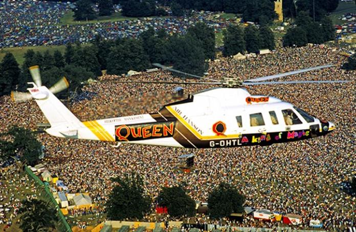Queen arrive by helicopter at Knebworth in southern England, August 9, 1986. (Image courtesy Denis O'Regan)