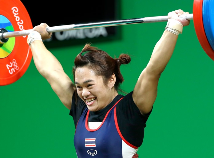 Gold medalist Sukanya Srisurat, of Thailand completes a successful lift in the women's 58kg weightlifting competition at the 2016 Summer Olympics in Rio de Janeiro, Brazil, Monday, Aug. 8. (AP Photo/Mike Groll)