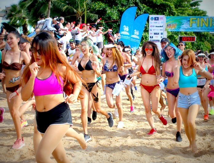 Scantily clad competitors race from the start line on Pattaya Beach during the inaugural Bikini Run on August 6.