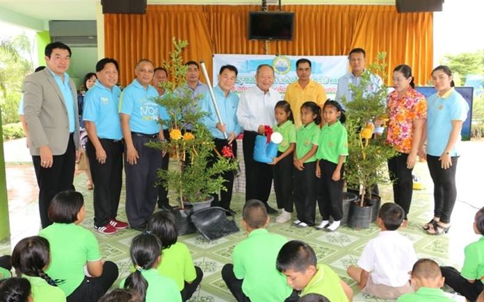 Mayor Mai Chaiyanit presides over an event where about 120 students, teachers and Nongprue officials planted trees at Tung Kom School.