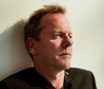 """Actor and singer Kiefer Sutherland poses for a photo during an interview in New York to promote his debut album, """"Down in a Hole"""". (AP Photo/Julie Jacobson)"""