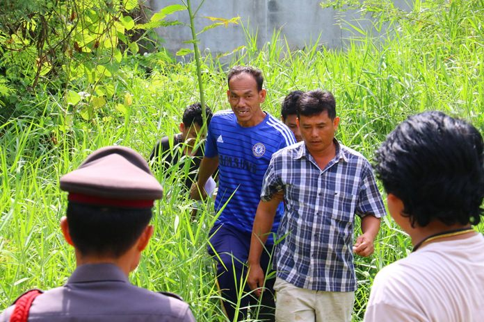 Somchai Boonyung (front, center) admitted to using a scythe to slash to death his rude, drug filled nephew.