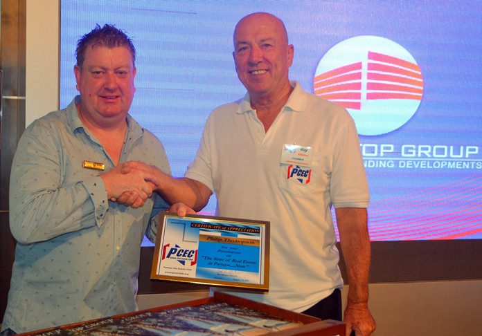 MC Roy Albiston presents the PCEC's Certificate of Appreciation to Philip Thompson for his talk about the condo real estate market in Pattaya.