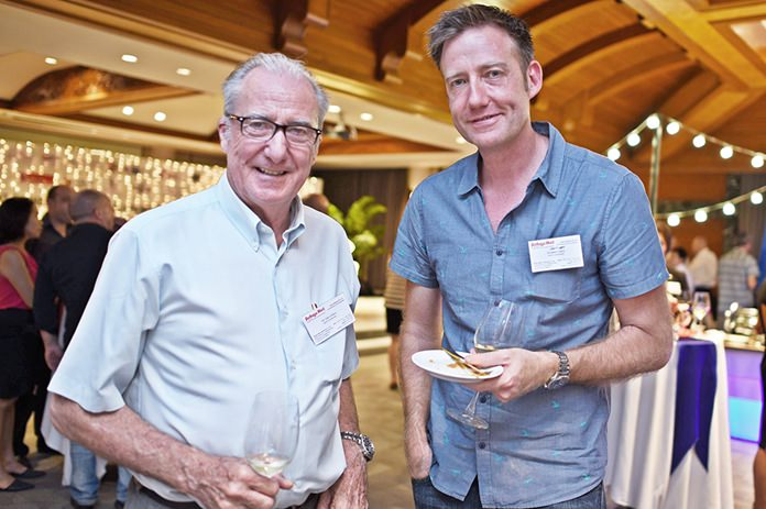 Dr. Iain Corness and his tall son Jonathan Corness.