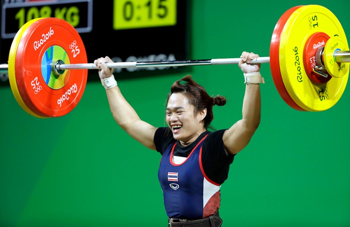 Sukanya Srisurat drops the barbell after a successful lift in the women's 58kg weightlifting competition at the 2016 Summer Olympics in Rio de Janeiro, Brazil, Monday, Aug. 8. (AP Photo/Mike Groll)