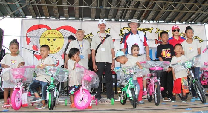 Selected students from the Fountain of Life Center are presented with a bicycle for their achievements and behaviour.