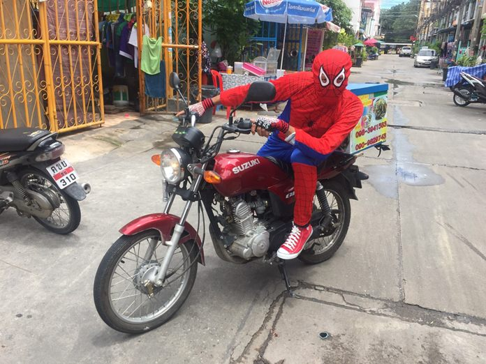 Chamnan Petchchu, 38, dressed as Spiderman, delivers spicy northeastern dishes.
