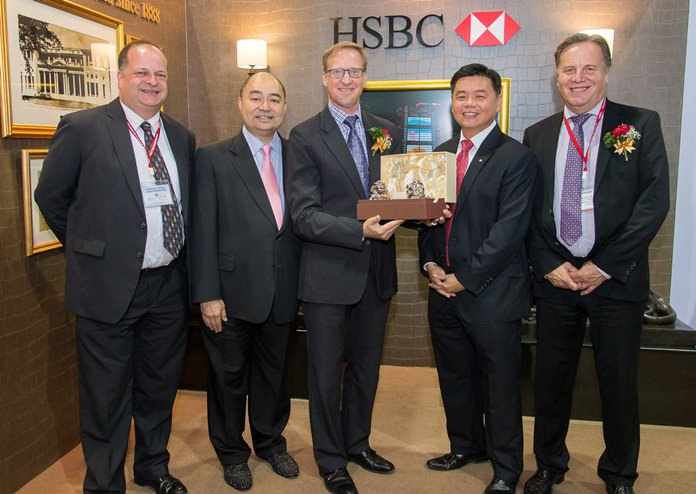 Kelvin Tan, Chief Executive Officer (2nd right) welcomes H.E. British Ambassador Brian Davidson to Thai-UK 2016. HSBC in Thailand initially opened for business in 1888 and was the first commercial bank in Thailand.