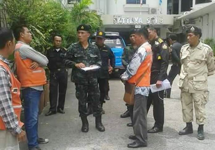 Pattaya city and military officials inspect motorbike taxi stands in South Pattaya to determine if a new registration system is working.