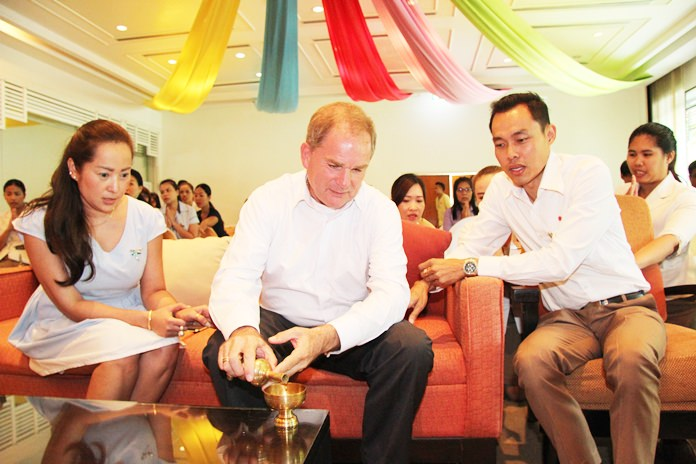 Robert Rijnders (center), senior vice president of operations and general manager for Onyx Hospitality Group's eastern region, leads the Amari management and staff in religious ceremonies.