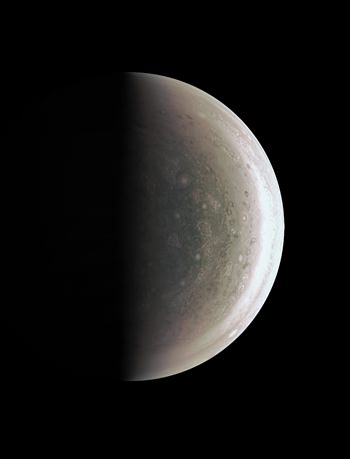 This Aug. 27, 2016 image provided by NASA provides a new perspective on Jupiter's south pole, seen when the Juno spacecraft was about 58,700 miles (94,500 kilometers) away. Unlike the equatorial region's familiar structure of belts and zones, the poles are mottled by clockwise and counterclockwise rotating storms of various sizes, similar to giant versions of hurricanes on Earth. (NASA/JPL-Caltech/SwRI/MSSS via AP)