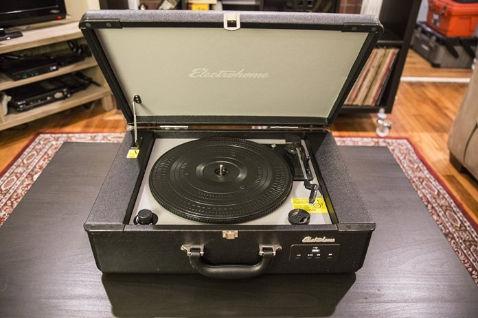 This Tuesday, Aug. 23, 2016, photo shows the Electrohome Archer Briefcase portable turntable on display in Decatur, Ga. The unit has built-in speakers and a headphone jack if the user wants to listen in private. A USB port on the front lets the listener play music from a flash drive with song files. (AP Photo/ Ron Harris)