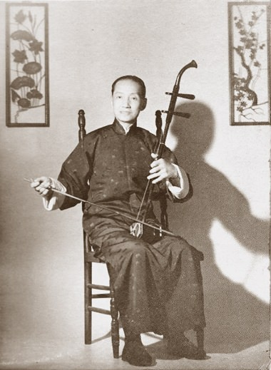 Composer Lü Wencheng playing the two-stringed erhu.