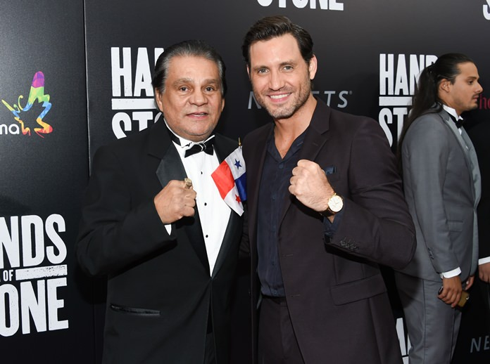 """Former professional boxer Roberto Duran (left) and actor Edgar Ramirez, who plays Duran in the film, pose together at the U.S. premiere of """"Hands of Stone"""" at the SVA Theatre on Aug. 22, in New York. (Photo by Evan Agostini/Invision/AP)"""