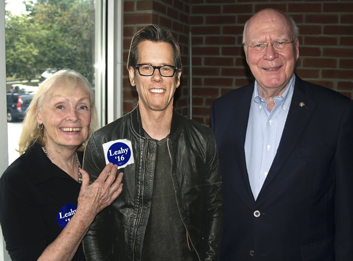 In this Aug. 1, 2016 photo provided by the Brattleboro Area Chamber of Commerce, U.S. Sen. Patrick Leahy, right, and his wife Marcelle pose with a life-size cardboard photo of actor Kevin Bacon in Brattleboro, Vt. (Gregory P. Lesch/Brattleboro Area Chamber of Commerce via AP)