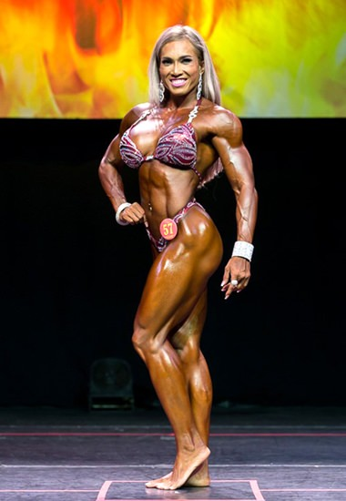 Penprakhai Tiangngok shows the form that won her first place in the IFBB Pro Women's fitness event held in Phoenix, Arizona on Sept. 10.