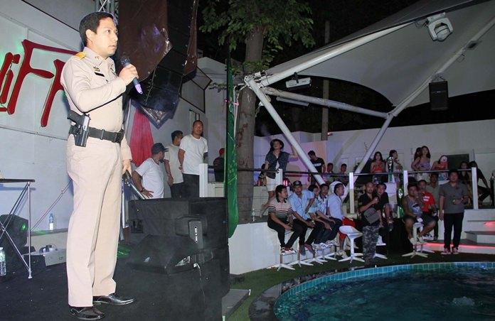 Pol. Lt. Poradit Jitramwong addresses a gathering at the Cliff Pool Club.