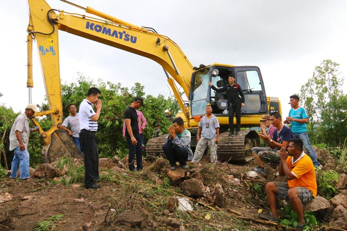 A former policeman and three contractors have been arrested for razing trees and digging up public land on Sattahip's Khao Malakoh.