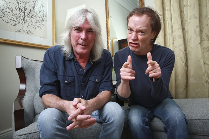 AC/DC bassist Cliff Williams (left) and guitarist Angus Young pose for a portrait in this Nov. 13, 2014 file photo. (Photo by Amy Sussman/Invision/AP)
