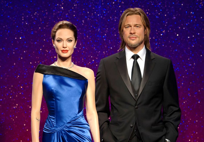 Wax figures resembling actors Angelina Jolie Pitt and Brad Pitt are shown on display at the Madame Tussauds wax museum in London. A spokeswoman for Tussauds said the figures have now been moved apart to mirror their real life separation. (Madame Tussauds via AP)