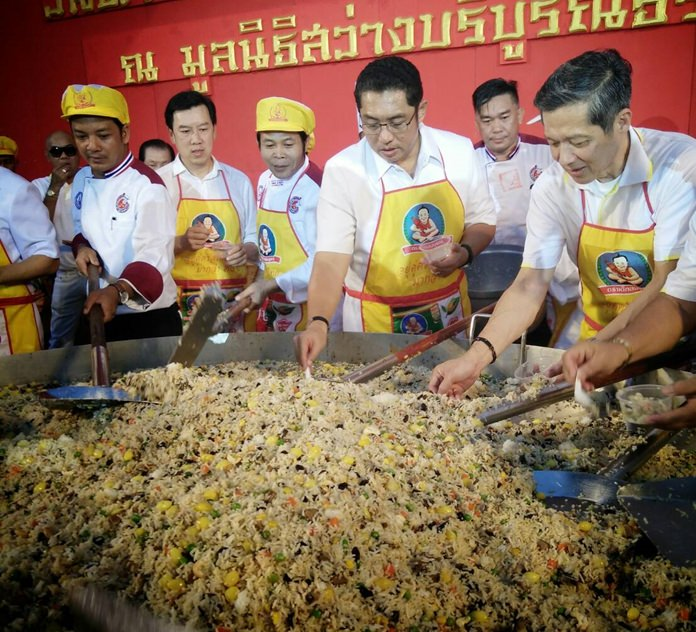 """Local dignitaries stir up this year's """"magic rice"""" dish for the masses."""