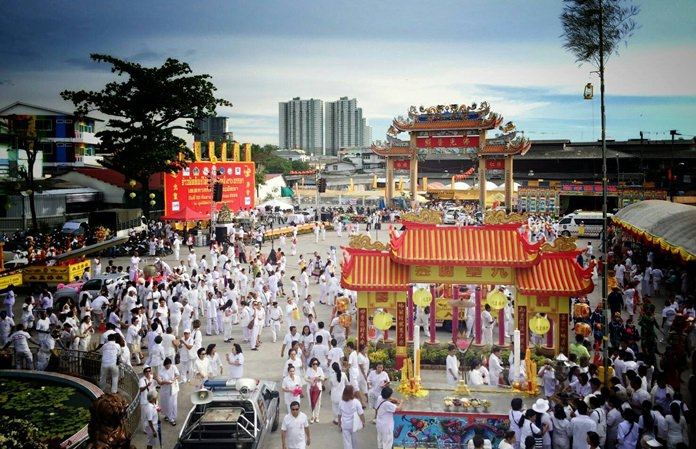 The Sawang Boriboon headquarters is bathed in white as followers arrive en masse to celebrate the beginning of this year's Vegetarian Festival.