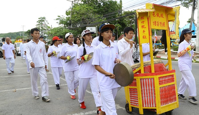 Students wear white and keep tradition in the Sattahip parade.