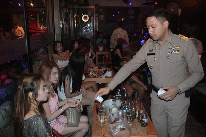 Pol. Lt. Poradit Jitramwong begins preliminary drug testing during the raid of the 18+ Club, which was found open after legal hours.