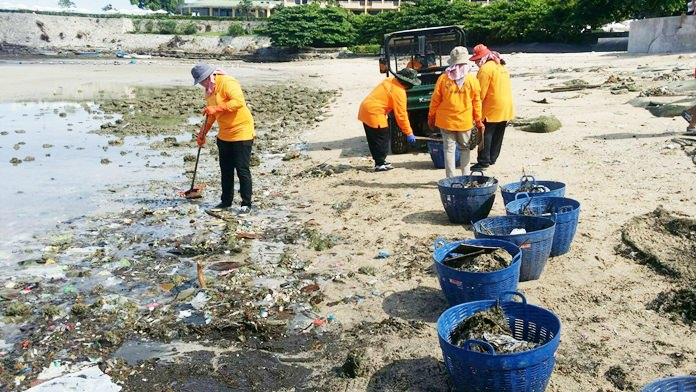 Public Health workers from Pattaya City Hall collect rubbish along Pattaya Beach in the aftermath of a recent storm.
