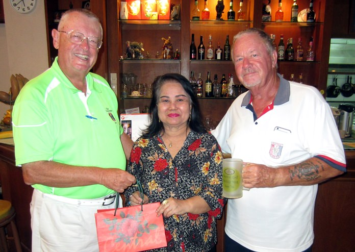 Golfer of the month Dick Warberg (left), Monthly Mug winner Barry Elphick (right) and Lek of BJ's Holiday Lodge.