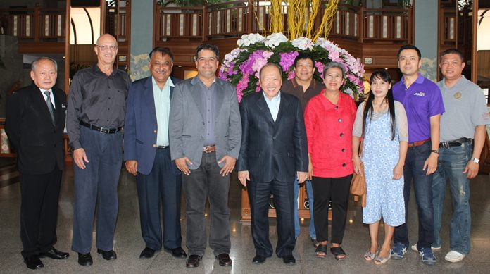 Friends including Philippe Delaloye (2nd left) gather for a group photo with Chatchawal in the spacious Cholchan Hotel lobby. They are flanked by Jakrapong Vitayasirikul (left) and Pin Krasang.