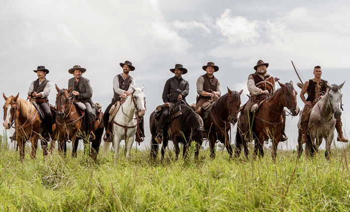 "From left, Byung-hun Lee, Ethan Hawke, Manuel Garcia-Rulfo, Denzel Washington, Chris Pratt, Vincent D'Onofrio and Martin Sensmeier appear in a scene from ""The Magnificent Seven."" (Sam Emerson/Sony Pictures via AP)"