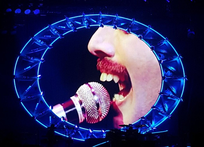 A giant screen pays homage to the late Freddie Mercury.